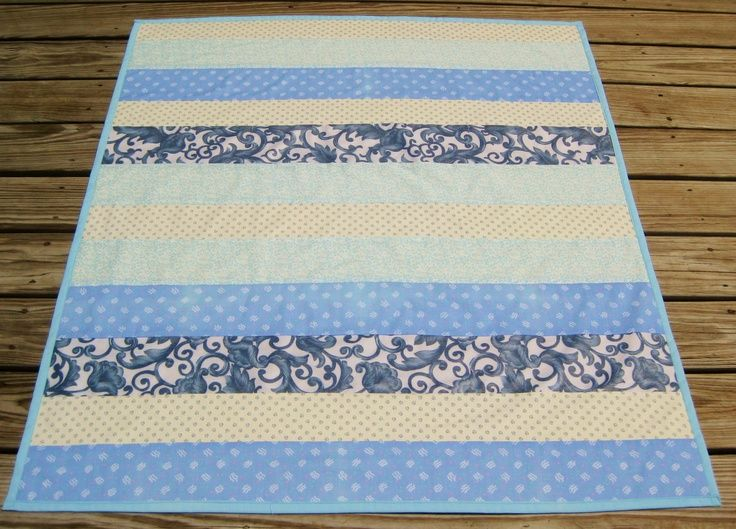 Strip quilt in blues..love the idea....different material