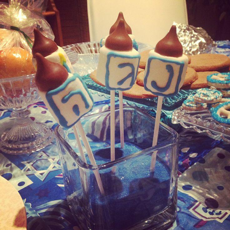 Homemade Hannukah Dreidel Centerpieces caramel hershey kisses kosher marshmallows blue scribbler icing tube Lolipop sticks Voila!