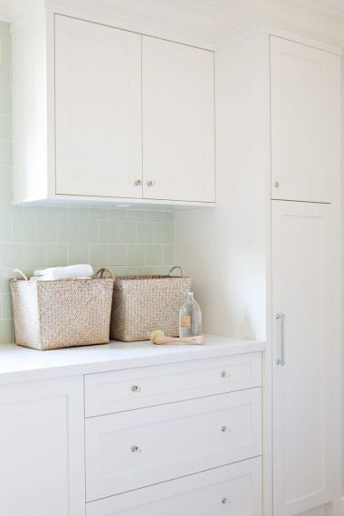 Kelly Deck Design - laundry/mud rooms - white, shaker, kitchen cabinets, white, quartz, countertops, seafoam, green, glass, subway tiles, backsplash, woven, baskets, laundry room cabinets, white laundry room cabinets,