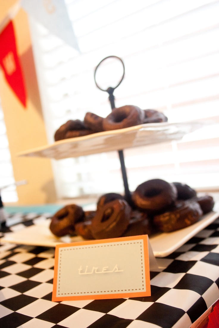 "Race car party food. ""Tires""... those little chocolate covered donuts."
