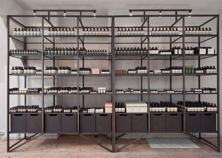 "Post-Office creates ""simple and elegant"" HQ for Aesop  steel, frame, shelves, display stand,"