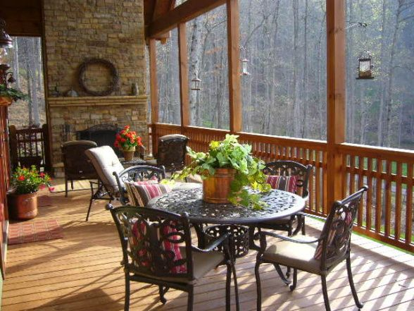 I love this screened porch with the fireplace.  What a cozy spot to sit and reflect on the day