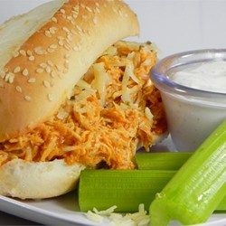 Slow Cooker Buffalo Chicken Sandwiches - Allrecipes.com | Add some cream cheese and Frank's Red Hot to round out the flavor