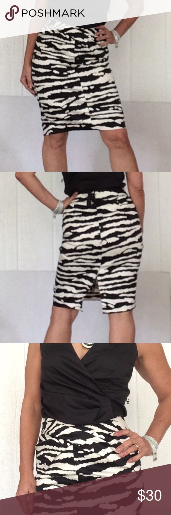 """MICHAEL KORS PENCIL SKIRT EUC Michael Michael Kors pencil skirt. Beautiful addition to your work wardrobe in this fully lined pencil skirt with back kick pleat. Front detail has crossover bands of fabric for slimming effect at waistline.   Zebra print. Hidden back zipper. No pulls, stains, rips or tears. Excellent condition only worn a few times.  All measurements are taken flat across and approximate length 23.5"""", waist 14.5"""". MICHAEL Michael Kors Skirts"""
