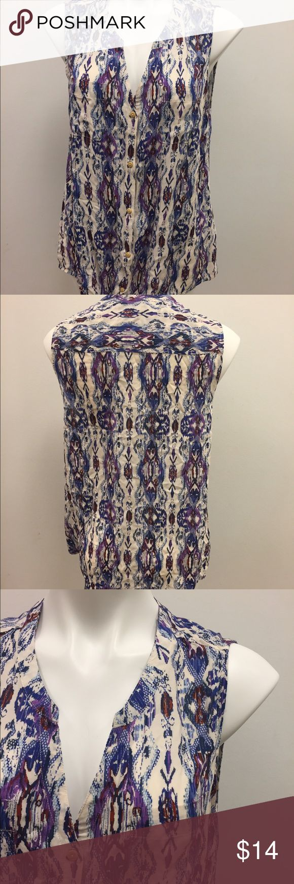 New with Tags! Tribal print button down Top Cute tribal print button up Sleeveless Blouse in a size large from dressbarn. It is brand new with tags attached. Blues and purples patterned with cream background. #tribalprint #new #nwt #print #dressbarn Dress Barn Tops Blouses