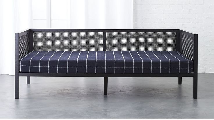 Shop boho black daybed.   The perfect setting for daily siestas.  Designed by Mermelada Studio in Spain, graceful daybed approaches sofa styling with the relaxed comfort of a bed.  Solid black-painted rubberwood frames airy panels handwoven of rattan.