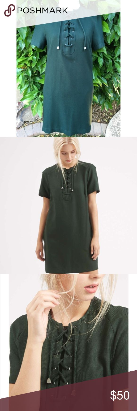 NWOT Topshop Lace-Up Tunic Dress Smock style dress in heavy twill fabric with eyelet lace up detail and concealed side pockets. Lined Topshop Dresses