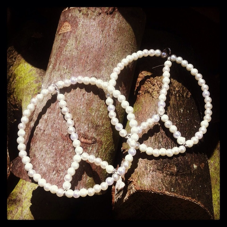 Pearl interpretation of peace sign earrings