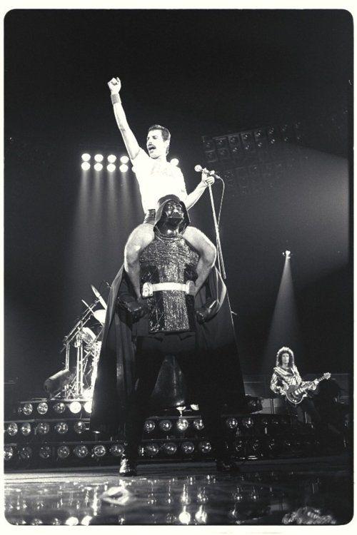 Freddie Mercury Sitting on Darth Vader's Shoulders