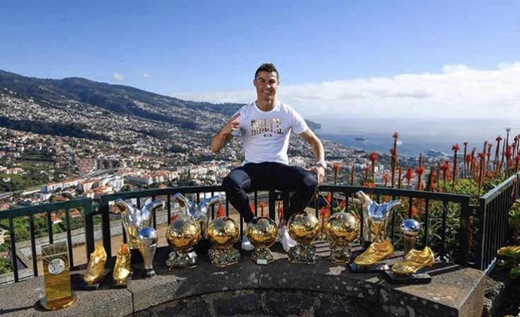 "Cristiano poses with all of his major individual awards in his Hometown!❤❤ Cris: ""When I played in the streets of Madeira and dreamed of reaching the top, I did not think I would take a picture like that. I dedicate this moment to my family, friends, teammates, coaches and club structures and selection. Special thanks to the fans. These trophies are yours too!"""