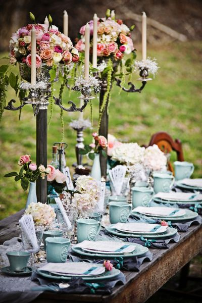 Gorgeous table setting: rustic wood, blue china, and fresh flowers.