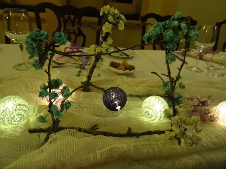 Rectangle made by branches of trees, paper flowers Table set for a Teacher of geometria