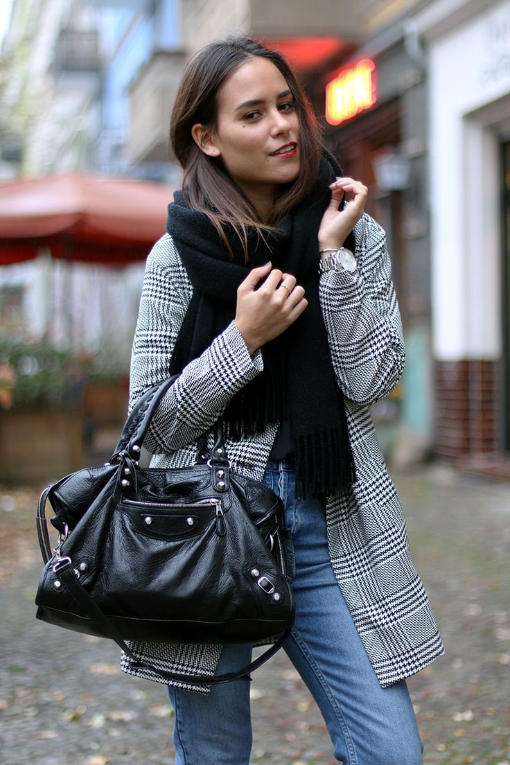 Nisi is wearing: Balenciaga Giant 12 City Bag, Houndstooth Blazer, Topshop Girlfriend Jeans, Loafers, Acne Studios Canada scarf