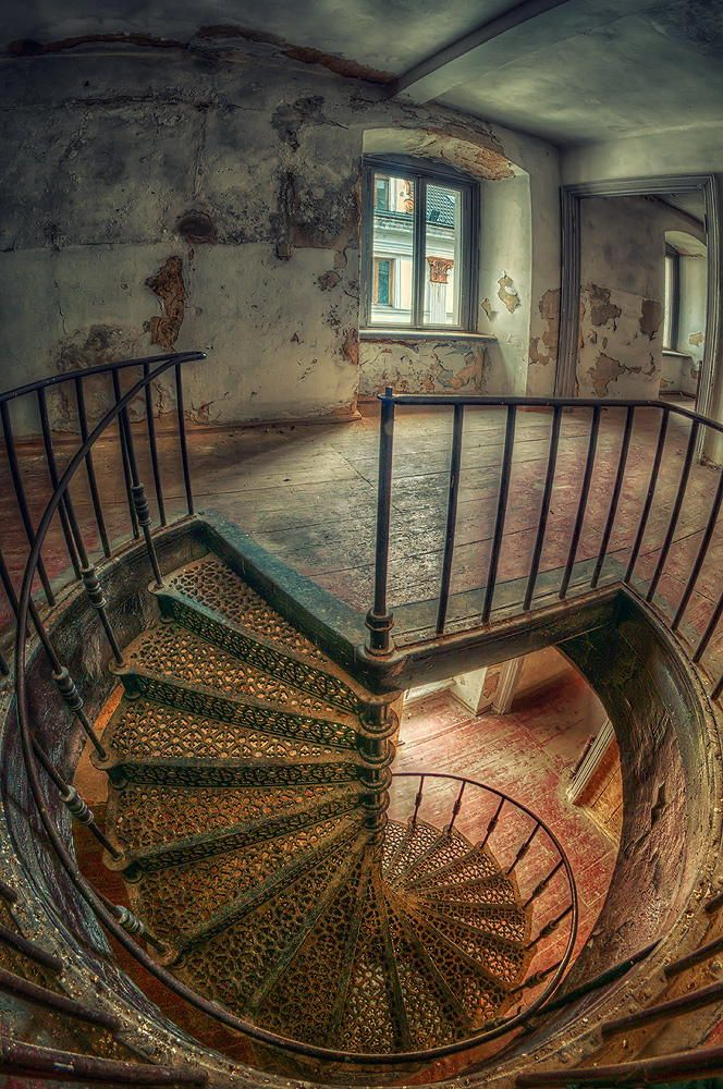 Spiral staircase in an abandoned palace in Poland.
