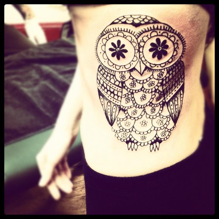 my owl tattoo, a mix between a sugar skull & an owl. love.