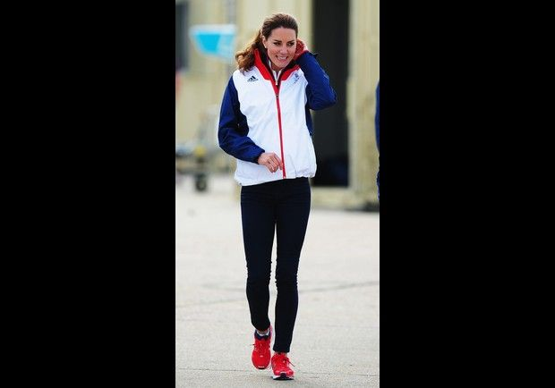 Different versions of the Team GB Olympic Kit designed by Stella McCartney were worn by Kate, including Adidas. The polo shirts were always paired with skinny jeans. But here, while watching the Women's Laser Radial sailing race, Kate Middleton wore the red, white and blue windbreaker with athletic pants and running sneakers to match.