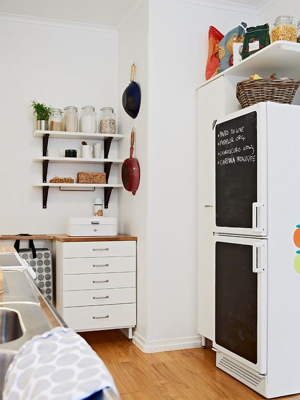 A white Swedish apartment - wood + white.  I like the blackboard facade on the fridge, open shelving too, as we're thinking.