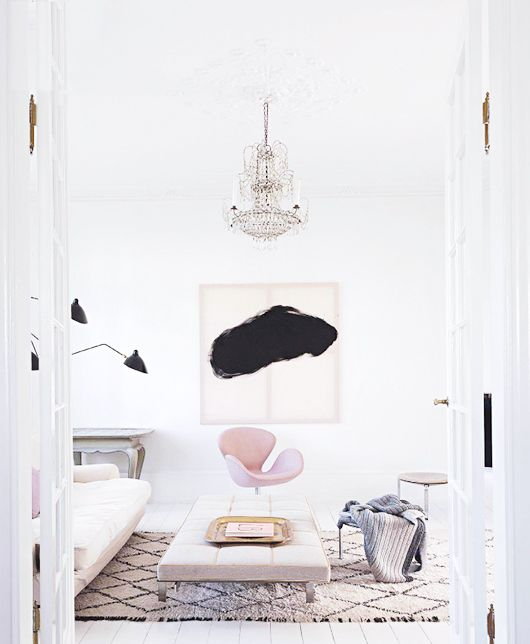 pink arne jacobson swan chair in crisp, clean white living room space / vogue living australia