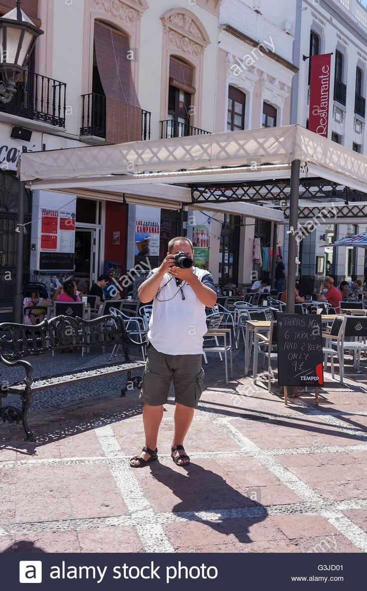 Download this stock image: photographer at work in the city of Ronda, Spain - G3JD01 from Alamy's library of millions of high resolution stock photos, illustrations and vectors.