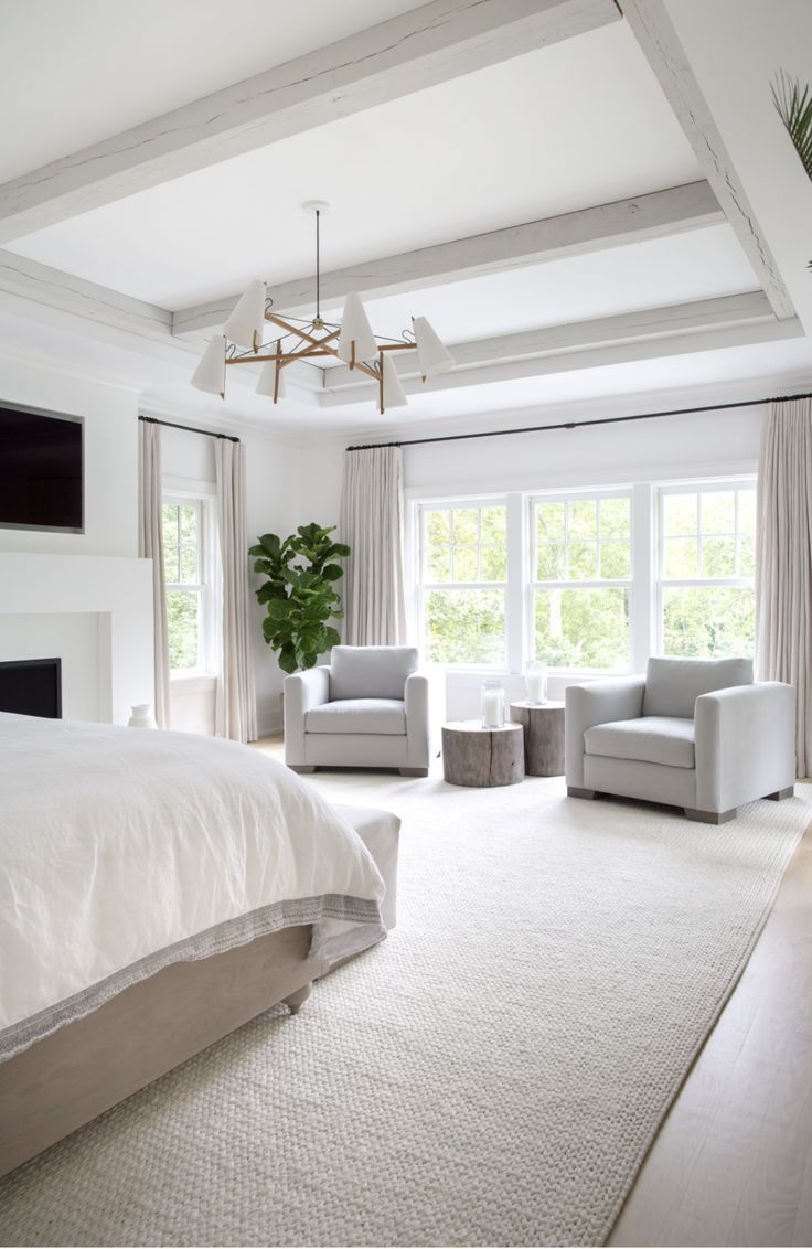 Large Master Bedroom With Extra Large Area Rug Brass Chandelier