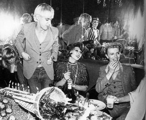 Iggy Pop and David Bowie with Romy Haag in a nightclub in West Berlin.