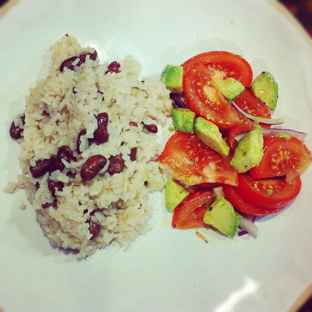 Jamaican rice and beans with tomato avocado salad
