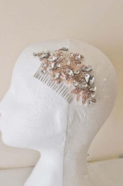 Blush Pink and Rose Gold Beaded Bridal Hair CombThis headpiece comprises of countless blush pink and rose gold beads and hand sewn crystal rhinestones set on light ivory floral lace. So pretty and delicate with an Art Deco influence. A classic and timeless beaded hair comb which will add a bit of yesteryear elegance to your special day. This lovely embellished bridal headpiece can be worn numerous ways: on the side of the head, atop a chignon or closer to the face on the hairline.The fine…