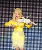 Dolly Parton shows her skills at her Better Day world tour stop in Concord, Calif., on July 24, 2011.