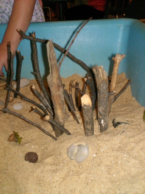 Closeup of the sensory table by folkmew, via Flickr    sand, twigs, stones, acorns, pinecones