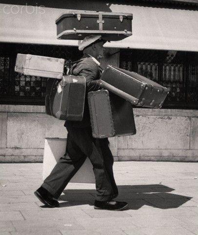 Man carrying many suitcases - 1970   #TuscanyAgriturismoGiratola