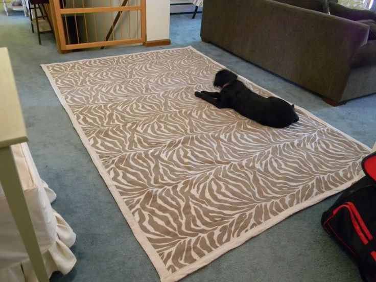 Fabric rug using upholstery yardage and a fabric dropcloth ... I see this with vintage barkcloth (if you could bring yourself to walk on vintage barkcloth) ...