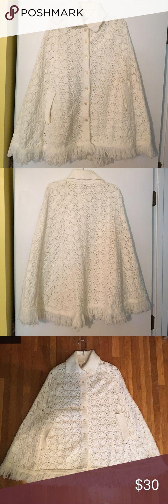Vintage Fringe Sweater Cape With Pockets Vintage fringe sweater cape. One size. Color is Ivory. Gorgeous knit with fringe detail, rib knit collar, pearlized buttons and side arm holes. Button front closure. No tags. Hand wash. In excellent condition. Sweaters Shrugs & Ponchos