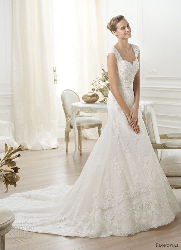 Lencie petit pois tulle wedding dress with rebrodé lace and belt with crystal gemstone embroidery, bodice with sweetheart neckline and lace straps.