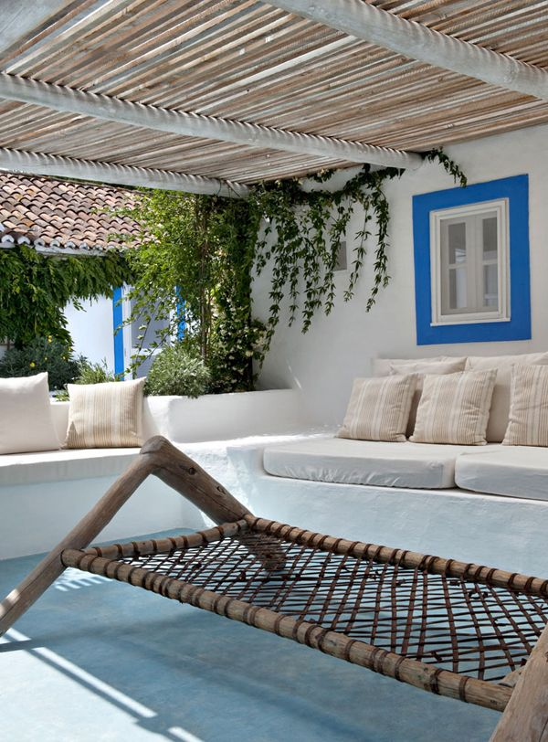 Use of bamboo and blue in this Portugese summer home - via The Style Files