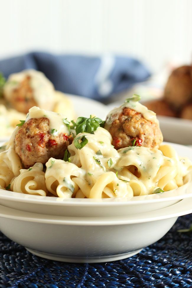 Inspired by Maggiano's Country Style Pasta, these Ricotta Turkey Meatballs with Sun-Dried Tomatoes and Garlic Asiago Cream Sauce are lighter and healthier than the restaurant version.