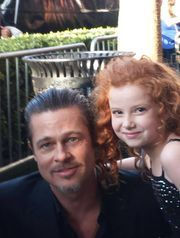 Brad with Francesca Capaldi at the premiere of 'Maleficent.' The little actress is in 'Dog with a Blog,' a favorite show of the Pitt-Jolie kids.