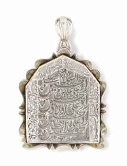 A calligraphic rock crystal pendant | Iran or Iraq, late 19th/early 20th century