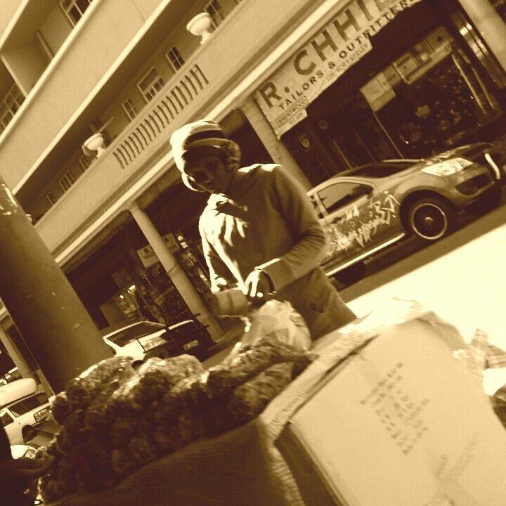 Street seller. Making a living in Joburg. Johannesburg city. Lomography. Photo overlay