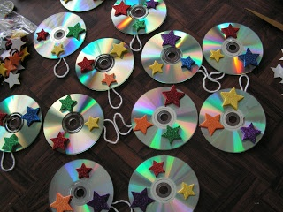 maybe just take up a collection of used cds and let kids draw on them, stick things to them, or wrap yarn around them to take home and hang as sun-catchers?  any other recycled cd crafts good for kids?