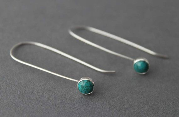 Are you the ultimate mininalist? Here is a pair of earrings for you... These earrings are made with sterling wire and 6mm Turquiose cabochon stones....just a dainty line with a colorful circle attached to the bottom. They come in a gift box. Length: 1.5 inches (3.81 cm)
