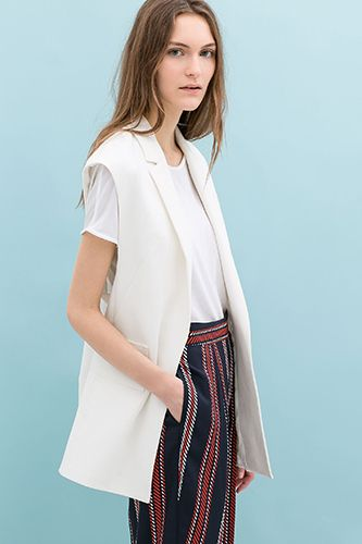 13 Vests That Make Throw-On-&-Go Dressing Way More Chic #refinery29  http://www.refinery29.com/oversized-vests#slide1  Zara Combined Waistcoat, $99.90, available at Zara.
