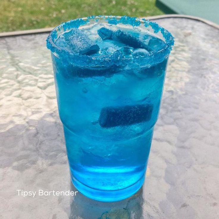 Sour Blue Cocktail - For more delicious recipes and drinks, visit us here: www.tipsybartender.com