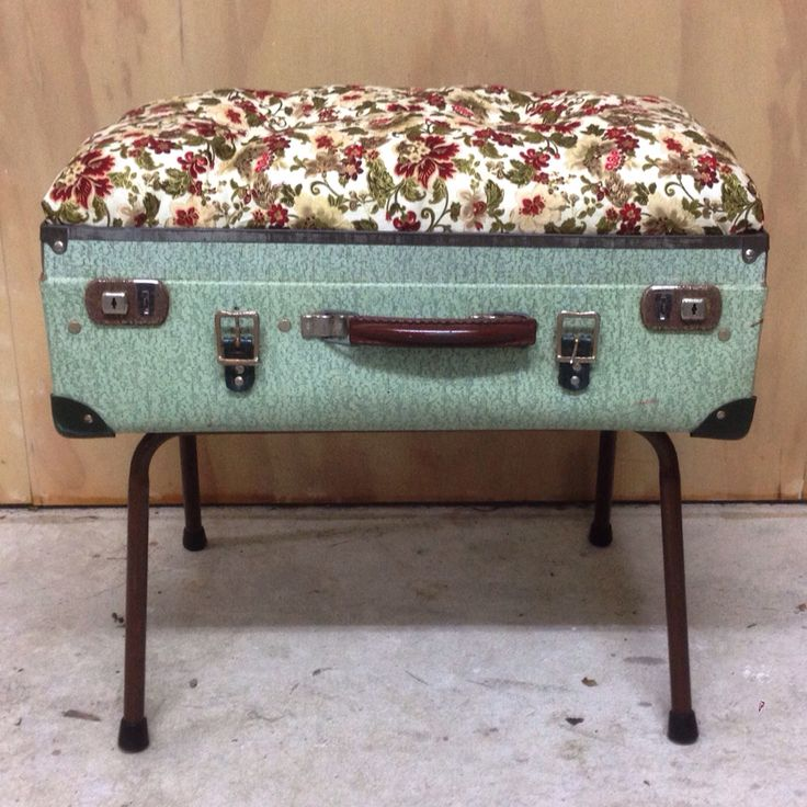 Suitcase stool made out of my great grandfathers old suitcase and recycled chair legs