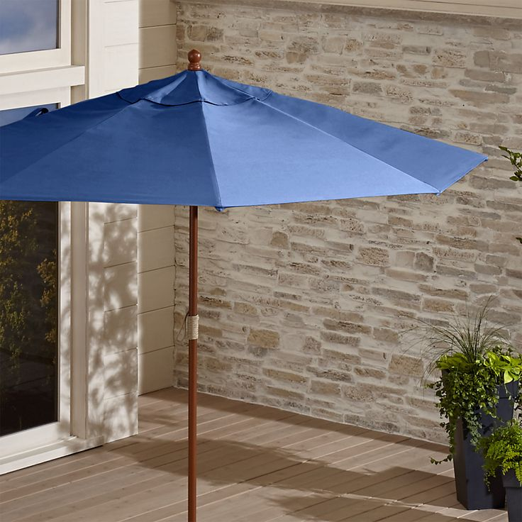 Shop 9' Round Sunbrella ® Mediterranean Blue Patio Umbrella with FSC Eucalyptus Frame. A protective outdoor umbrella canopy in Mediterranean blue screens out 98% of the sun's UV rays thanks to fade- and mildew-resistant Sunbrella acrylic.