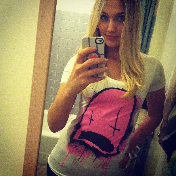Naomi Kyle wearing the Dripping Ghost White Tee from Young Ghosts Clothing