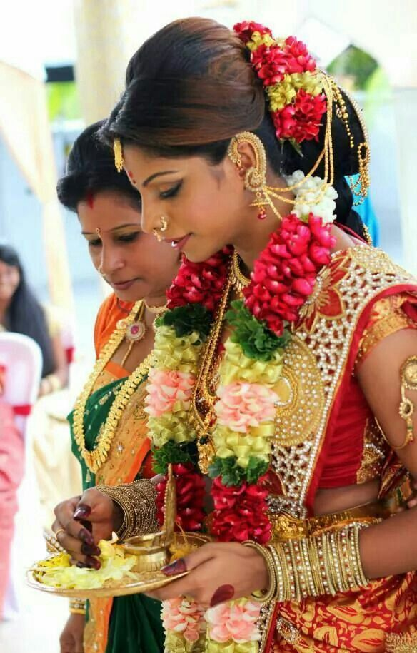 South Indian bride. Cutwork silk sari. Braid with pouf and fresh flowers. Hindu bride. Tamil bride.