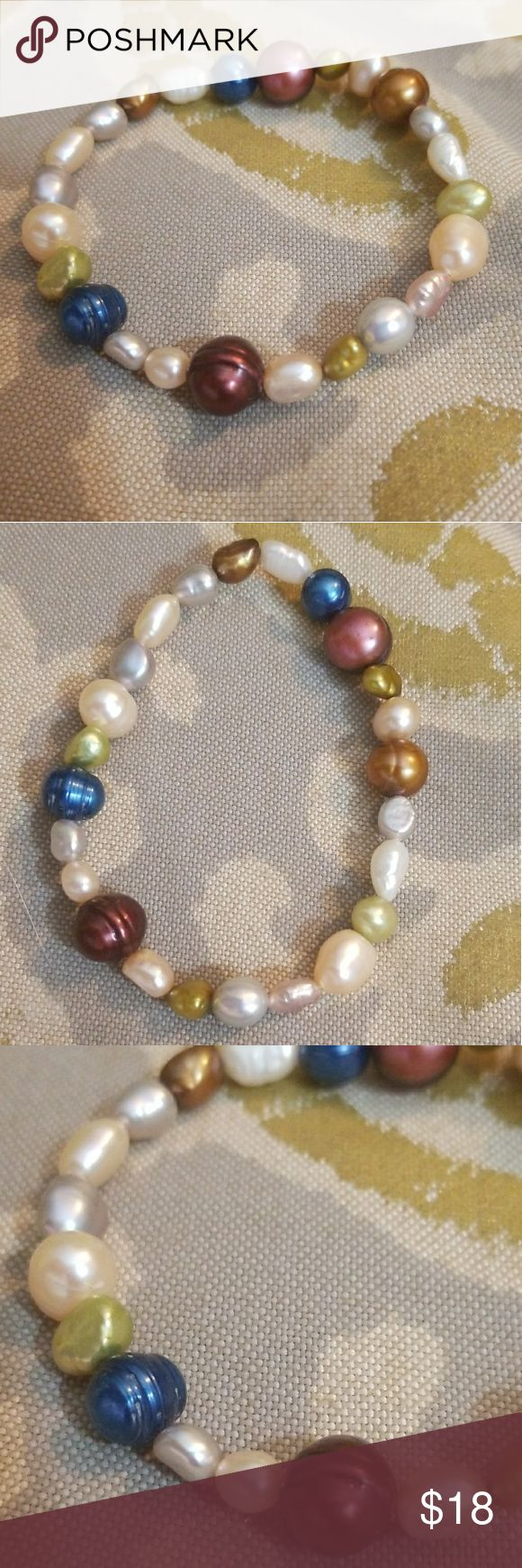 Real Fresh Water Pearls Bracelet This bracelet is made from real fresh water pearls in assorted colors never worn and it's stretchy to put on and take off. Jewelry Bracelets