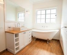 Claw-foot freestanding bath.  Woodgrain tiles.