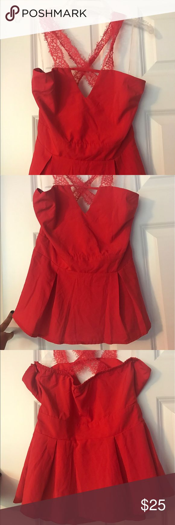 Red peplum top with lace straps NEVER BEEN WORN Tobi red peplum top with lace straps that cross in the back.. brand new never been worn Tobi Tops