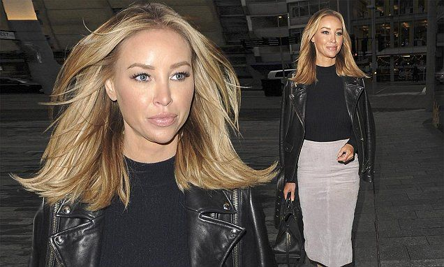 Lauren Pope looks ready for business in chic suede pencil skirt